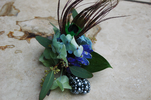 peacock feather wrist corsage wedding flowers studio stems